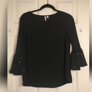 Pearl sleeved black top